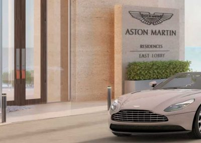 3D rendering sample of an Aston Martin car arriving at Aston Martin Residences' entrance.